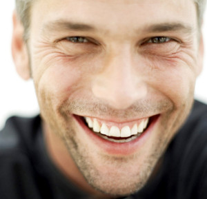 Young Man Laughing --- Image by © Royalty-Free/Corbis